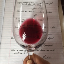 Red wine against paper